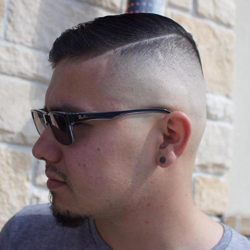 side part men's haircut with shaven sides