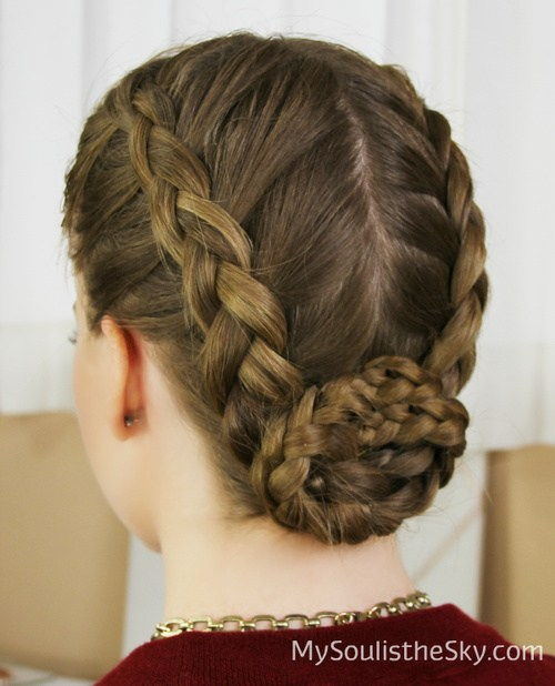 center-delt braided updo with a bun