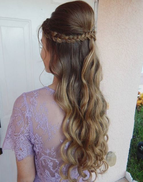 long half up half down hairstyle with a bouffant