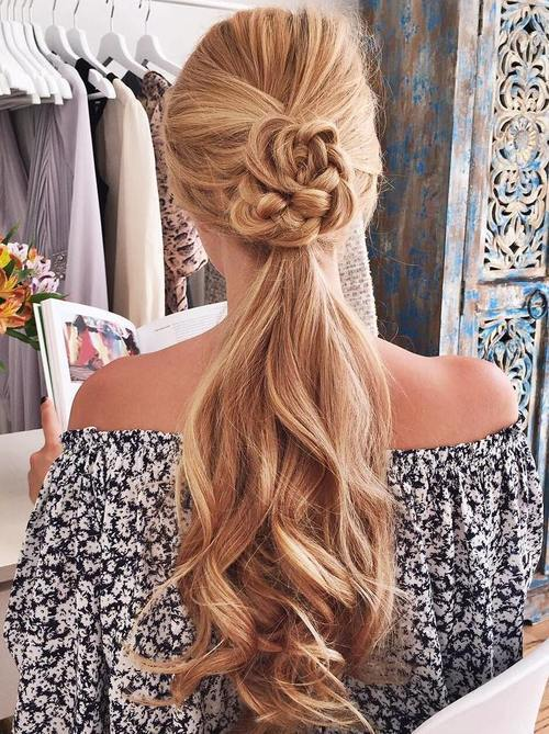 dugo ponytail hairstyle with a braided detail