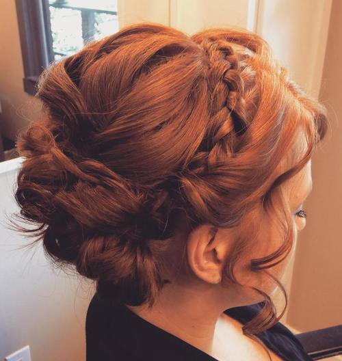red curly updo with a headband braid