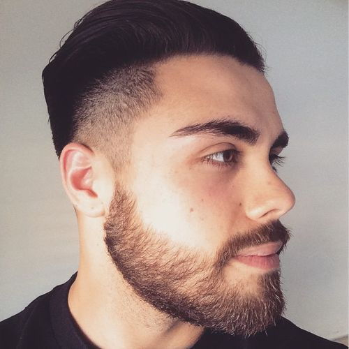 obrijane sides combed back hairstyle with beard