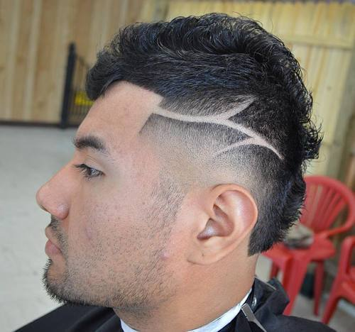smailas fade Mohawk with shaved designs