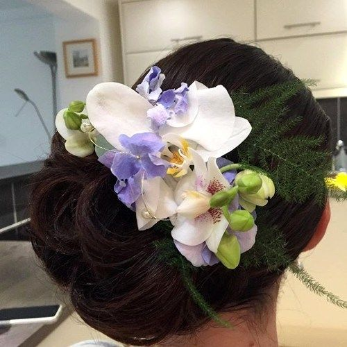 strana updo with hair flowers for prom