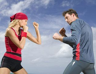 man and woman sparring