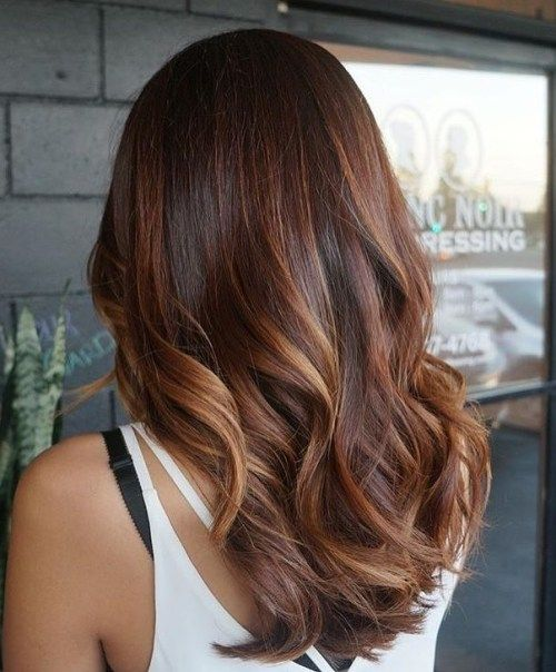 dugo dark brown hair with auburn balayage