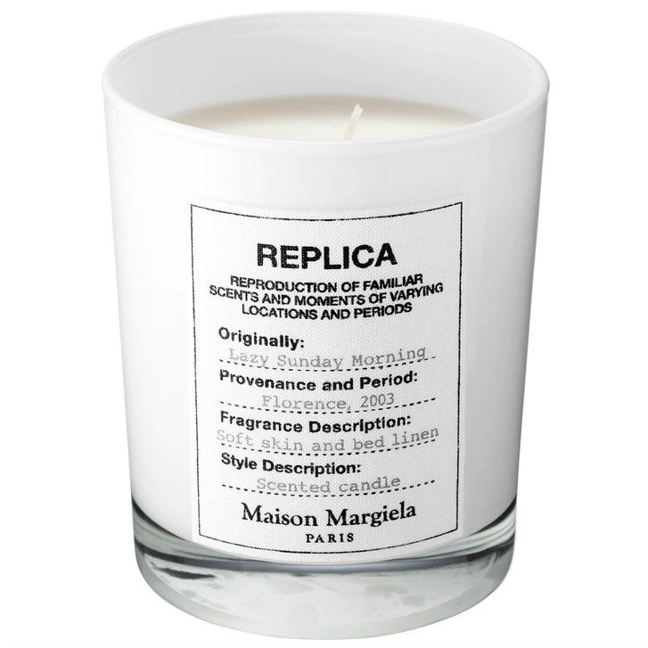Maison Margiela Lazy Sunday Morning Candle in a white glass cup