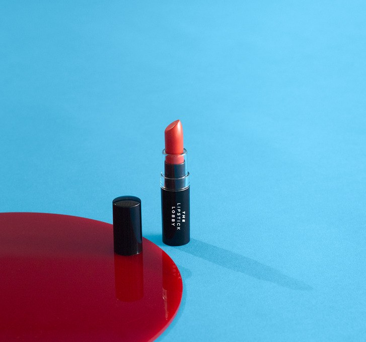 A tube of red lipstick from philanthropic beauty brand, The Lipstick Lobby