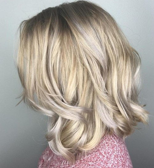 auksinis blonde hair with silver highlights